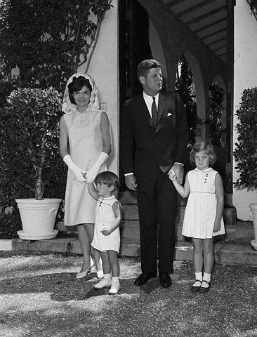 President John F. Kennedy stands with his wife, Jackie, and two children, John, Jr., and Caroline. The family attended a private Mass at the home of Joe Kennedy in Palm Beach. April 14, 1963 Palm Beach, Florida, USA
